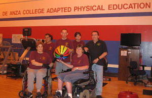 six students in Adapted Physical Education gym