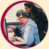Assistive Technology Instructor trains student in computer lab