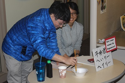 students doing calligraphy