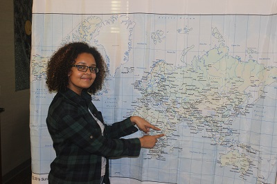 student in front of map