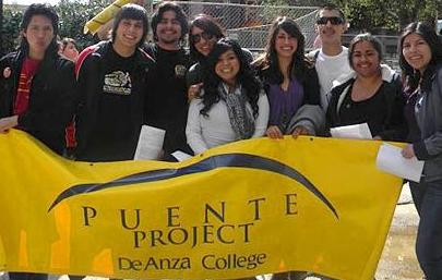 Students holding Puente banner