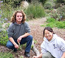 Two environmental studies students working on outdoor project